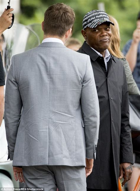 Ryan Reynolds suits up in grey filming The Hitman's