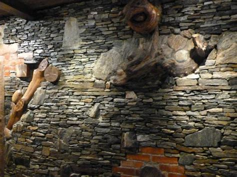 Unusual stone & wood wall in dining room - Picture of