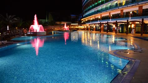 The Swimming Pool With Fountains In Night Illumination At